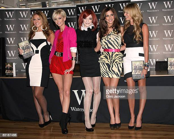 Kimberley Walsh Sarah Harding Nicola Roberts Cheryl Cole and Nadine Coyle of Girls Aloud pose for a photograph during a book signing for their new...