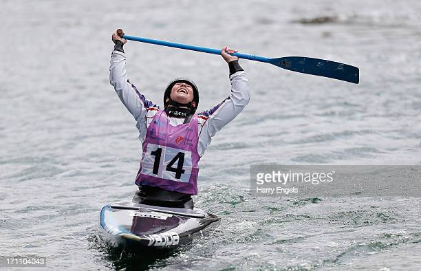 Kimberley Woods of Great Britain celebrates winning the Women's C1 Final during the Canoe Slalom World Cup at Cardiff Bay on June 22 2013 in Cardiff...