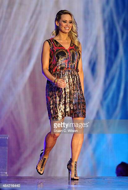 """Kimberley Wyatt approaches the judges panel during the second live show of 2014's """"Got To Dance"""" at Earls Court on August 26, 2014 in London, England."""