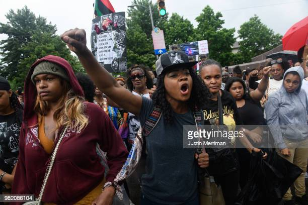 Kimberly Andrews of the North Side right and Lavida Caldwell of Washington Pa left chant Three shots in the back How do you justify that as they...