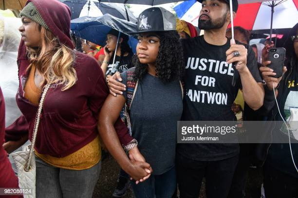Kimberly Andrews of the North Side right and Lavida Caldwell of Washington Pa left protest the police shooting of Antwon Rose during a Juneteenth...