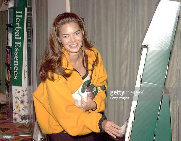 Kimberly Ann Pressler MISS USA 1999 grabs a handful of Clairol Herbal Essence products following The Cairol Herbal Essences Style Award Seminar on...