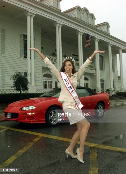 Kimberly Ann Pressler Miss USA 1999 of Franklinville New York poses for photographers in front of her new Camaro at The Grand Palace in Branson...