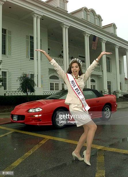 Kimberly Ann Pressler Miss USA 1999 of Franklinville New York poses for photographers Saturday Feb 6 1999 in front of her new Camaro at The Grand...