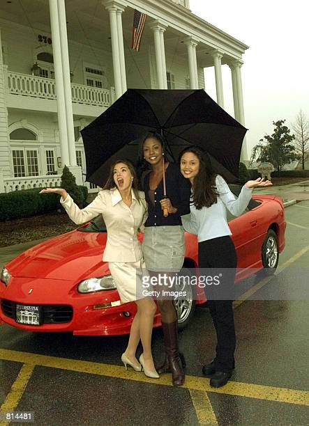 Kimberly Ann Pressler Miss USA 1999 Wendy FitzWilliam Miss Universe 1998 and Vanessa Minnillo Miss Teen USA 1998 pose for photographers at The Grand...