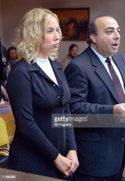 Kimberly Anne Mathers stands with her attorney during a hearing on charges of disturbing the peace in October 2 2001 at the 37th District Court in...