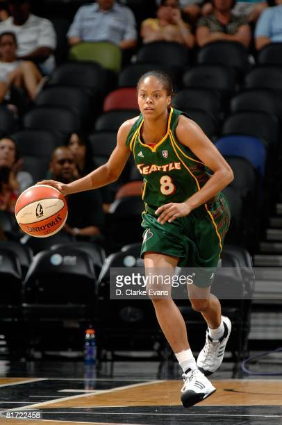 Kimberly Beck of the Seattle Storm pushes the ball upcourt against the San Antonio Silver Stars during the WNBA game on June 13 2008 at the ATT...