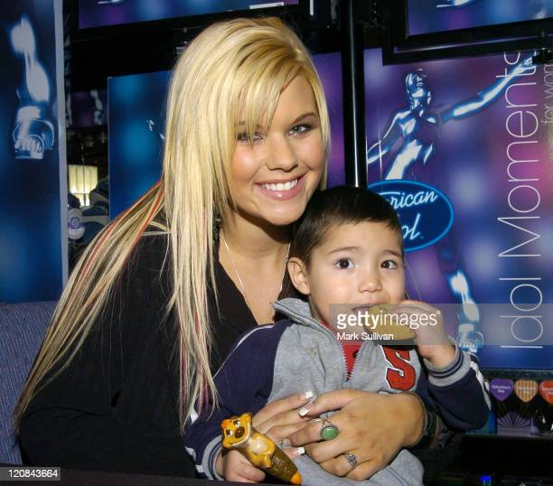 Kimberly Caldwell and young fan during Kimberly Caldwell Launches 'American Idol' Fragrance at JC Penney in Downey California United States