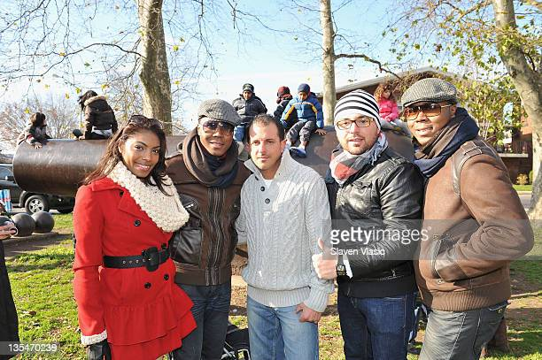 Kimberly Cheri Antoine Von Boozier David Annarummo DJ Jove and Andre Von Boozier attend the Help Santa Stuff a Buss Full of Toys event at the Cannon...