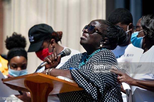 Kimberly Cummings an aunt of Ahmaud Arbery speaks to demonstrators during a protest of the shooting death of her nephew at the Glynn County...