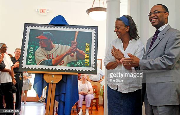 Kimberly Doby reacts as a new United States Postal Service stamp dedicated to her late father Larry Doby is unveiled during a ceremony at the Camden...