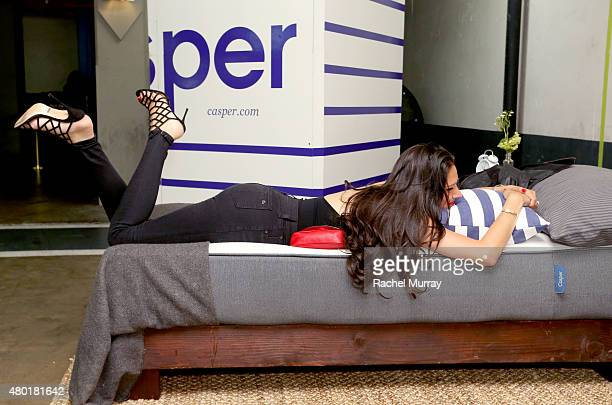 Kimberly Geller checks out the Casper mattresses during Casper's LA celebration at Blind Dragon on July 9 2015 in West Hollywood California