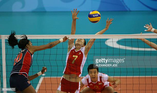 Kimberly Glass of US in action against China during a Women's Preliminary Olympic Volleyball Pool B match at the Capital Gymnasium in Beijing on...