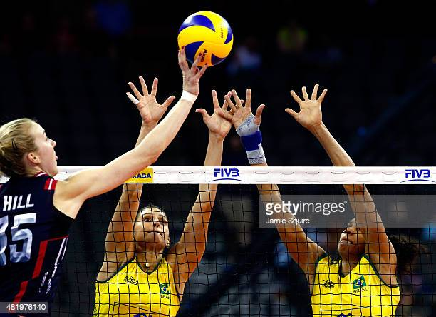 Kimberly Hill of the USA tips the ball over the net as Monique Marinho Pavao and Juciely Cristina Barreto of Brazil defend during the final round...