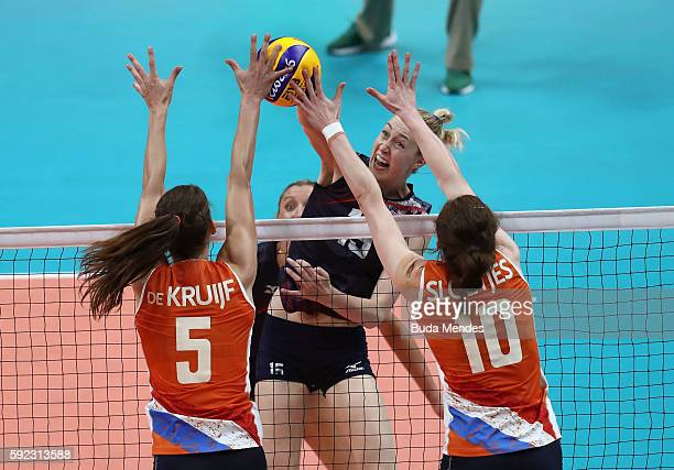 Kimberly Hill of United States spikes the ball against Robin de Kruijf and Lonneke Sloetjes of Netherlands during the Women's Bronze Medal Match...