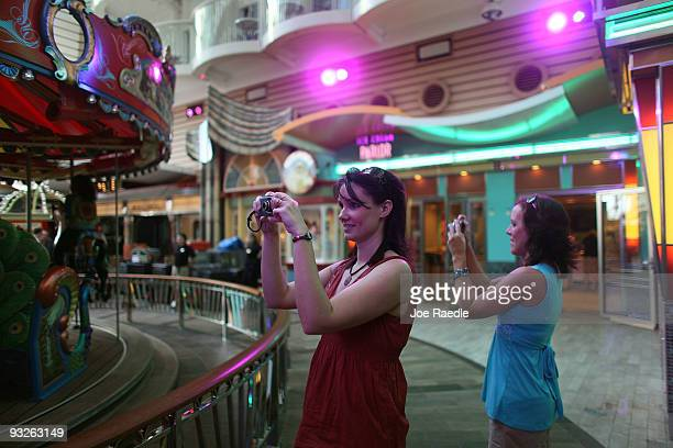 Kimberly Kane and Rachel Kessinger take photographs as they admire the cruise ship Oasis of the Seas on November 20 2009 in Port Everglades Florida...