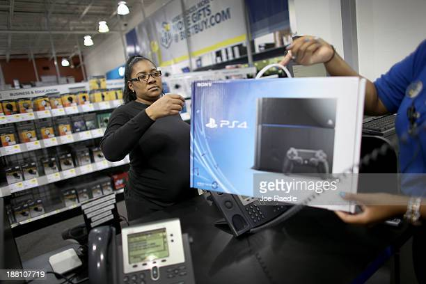 Kimberly Lee purchases a Sony Playstation 4 at Best Buy after they went on sale at midnight on November 15 2013 in Pembroke Pines Florida PlayStation...