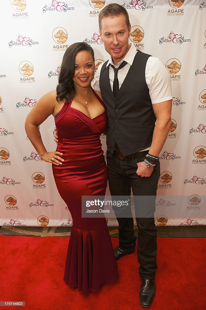 Kimberly Locke and Phoenix attend the Agape Animal Rescue 5th Annual Glitter & Glam gala at the Hutton Hotel on July 28, 2013 in Nashville, Tennessee.