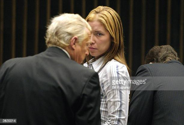Kimberly Mathers looks at her attorney immediately following her appearance before Judge Ed Servitto at Macomb County Circuit Court December 18 2003...