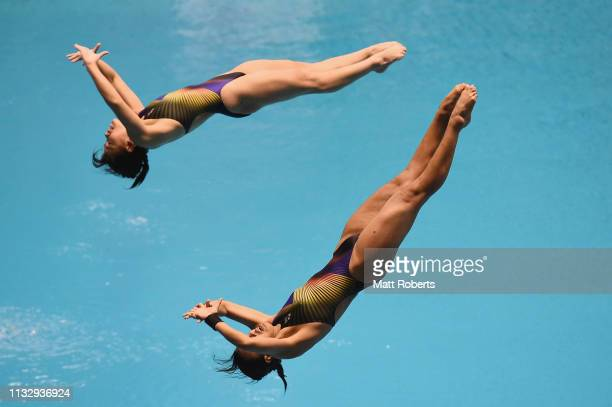 Kimberly Qian Ping Bong and Nur Dhabitah Binti Sabri of Malaysia compete during the Women's 3m Synchro Springboard Final on day one of the FINA...