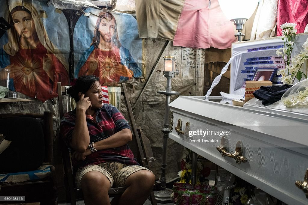 Kimberly Sailog watches over the coffin of her daughter, Christine Joy Sailog, 12 years old, on Christmas Eve December 24, 2016 in Laguna, Philippines. The young girl was killed when an unidentified gunman shot at an alleged drug suspect which also hit the girl during the traditional Christmas dawn mass in a church. Philippine president Rodrigo Duterte has said he wanted the Constitution amended to allow Philippine leaders to wield martial law powers without judicial and congressional approval, a move he said is necessary to contain the ongoing 'drug menace' and maintain peace and security in the country. Around 5,882 people have been killed across the country since President Rodrigo Duterte launched his war on illegal drugs five months ago, according to figures from the Philippine National Police. An average of 25 victims were killed daily during the five-month period, and police kill 97 percent of those they shoot, leaving 33 dead for every person wounded according to the figures. Last October, Duterte himself said the country could expect about 20,000 or 30,000 more deaths in his administration's bloody war on drugs.