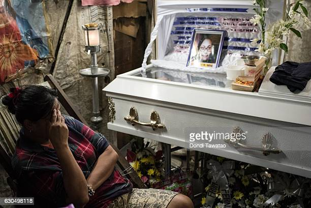 Kimberly Sailog watches over the coffin of her daughter Christine Joy Sailog 12 years old on Christmas Eve December 24 2016 in Laguna Philippines The...