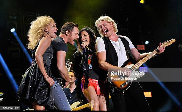 Kimberly Schlapman Jimi Westbrook Karen Fairchild and Phillip Sweet of the band Little Big Town perform at LP Field at the 2014 CMA Festival on June...