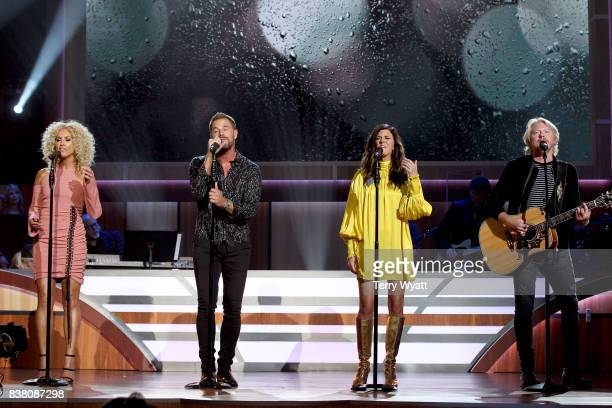 Kimberly Schlapman Jimi Westbrook Karen Fairchild and Phillip Sweet of Little Big Town perform onstage during the 11th Annual ACM Honors at the Ryman...