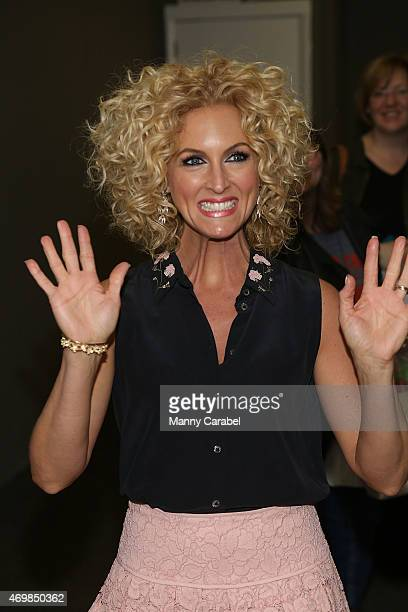 """Kimberly Schlapman of Little Big Town and Kimberly's Southern Kitchen show signs copies of her new cookbook """"Oh Gussie!"""" at Bookends Bookstore on..."""