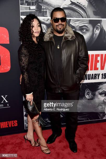 Kimberly Woodruff and O'Shea 'Ice Cube' Jackson attend the premiere of STX Films' Den of Thieves at Regal LA Live Stadium 14 on January 17 2018 in...