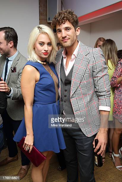 Kimberly Wyatt and Max Rogers attend the launch of Urban Expression by Swatch at Blackall Studios on August 14 2013 in London England