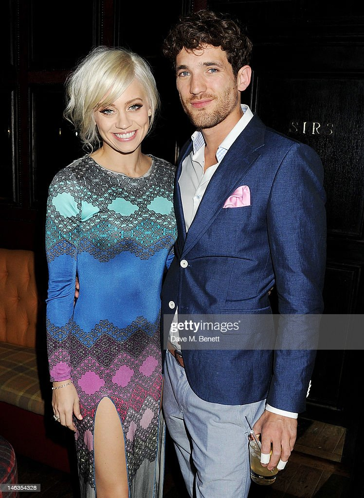 Kimberly Wyatt (L) and model Max Rogers attend as Tommy Hilfiger hosts a cocktail party to celebrate the launch of London Collections: Men at The Scotch of St. James London on June 14, 2012 in London, England.