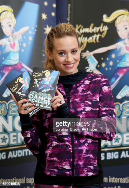 Kimberly Wyatt with her new book 'Billie's Big Audition' during a launch event held at Pineapple Dance Studios in London