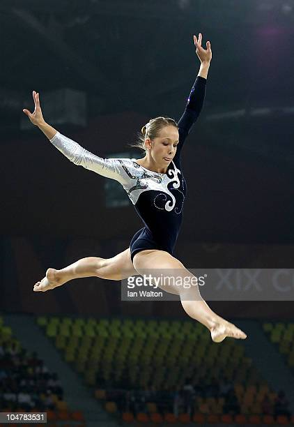 KimberlyAnn Van Zyl of Namibia in action on the beam during the Women's Artistic Gymnastics Qualification at IG Sports Complex during day two of the...