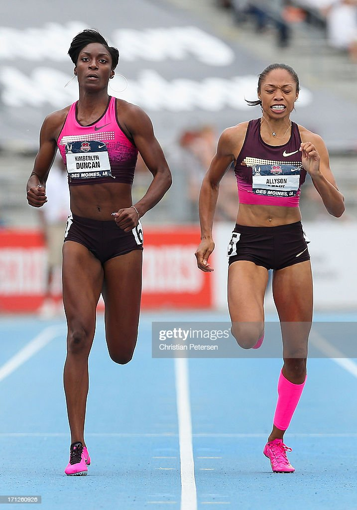 Kimberlyn Duncan (L) leads Allyson Felix en route to winning the Women's 200 Meter Dash final on day four of the 2013 USA Outdoor Track & Field Championships at Drake Stadium on June 23, 2013 in Des Moines, Iowa.