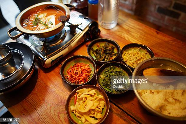 Kimchichige (fermented cabbage) nabe and ingredients of bibimbap, Seoul, South Korea