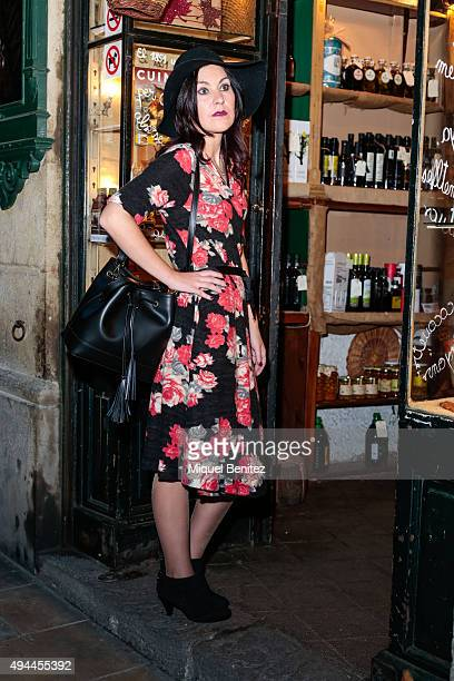 Kimera poses wearing DR Bloom black hat flower print dress and handbag and Blow@Born vintage shoes at the el Born distrcit on October 24 2015 in...