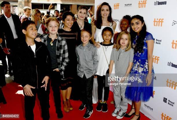 Kimhak Mun Shiloh JoliePitt Nora Twomey Knox Leon JoliePitt Angelina Jolie Zahara JoliePitt Vivienne JoliePitt and Saara Chaudry attend 'The...