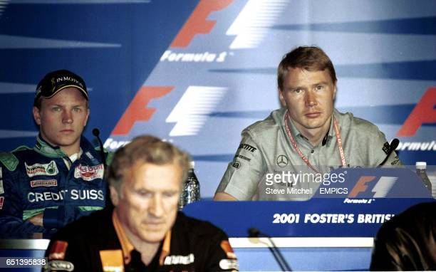 Kimi Raikkonen and Mika Hakkinen talk to the media at a press conference on practice day at the British Grand Prix
