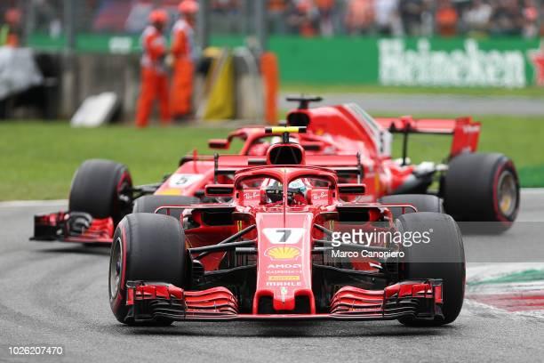 Kimi Raikkonen and Sebastian Vettel of Scuderia Ferrari in the paddock during the Formula One Grand Prix of Italy
