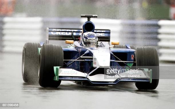 Kimi Raikkonen drives through the rain during the practice of the British Grand Prix