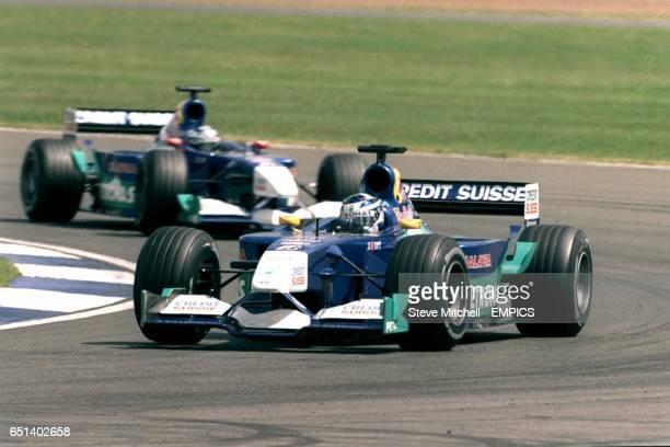 Kimi Raikkonen leads Sauber team mate Nick Heidfeld