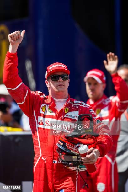 Kimi Raikkonen of Ferrari and Finland & Sebastian Vettel of Ferrari and Germany during qualifying for the Monaco Formula One Grand Prix at Circuit de...
