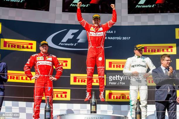 Kimi Raikkonen of Ferrari and Finland Sebastian Vettel of Ferrari and Germany Valterri Bottas of Mercedes and Finland during the Formula One Grand...