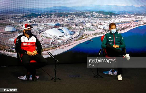 Kimi Raikkonen of Finland and Alfa Romeo Racing and Sebastian Vettel of Germany and Aston Martin F1 Team talk in the Drivers Press Conference during...