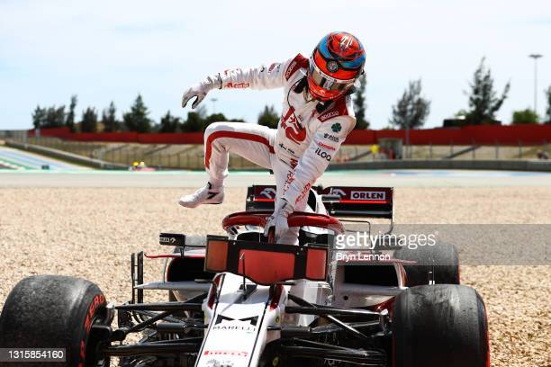 Kimi Raikkonen of Finland and Alfa Romeo Racing climbs out of his car after stopping in the gravel during the F1 Grand Prix of Portugal at Autodromo...