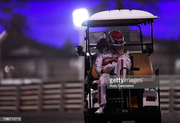 Kimi Raikkonen of Finland and Alfa Romeo Racing is given a lift back to the pits after stopping on track during practice ahead of the F1 Grand Prix...