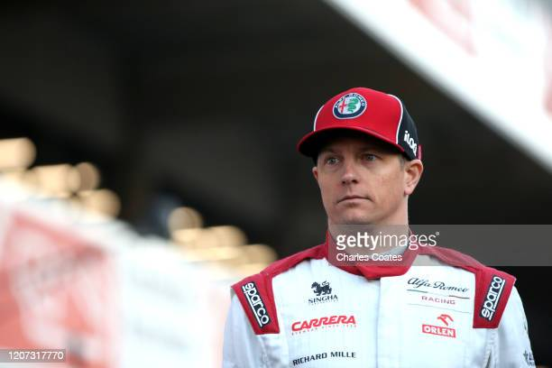 Kimi Raikkonen of Finland and Alfa Romeo Racing looks on at the roll out of the Alfa Romeo Racing C39 Ferrari during day one of Formula 1 Winter...
