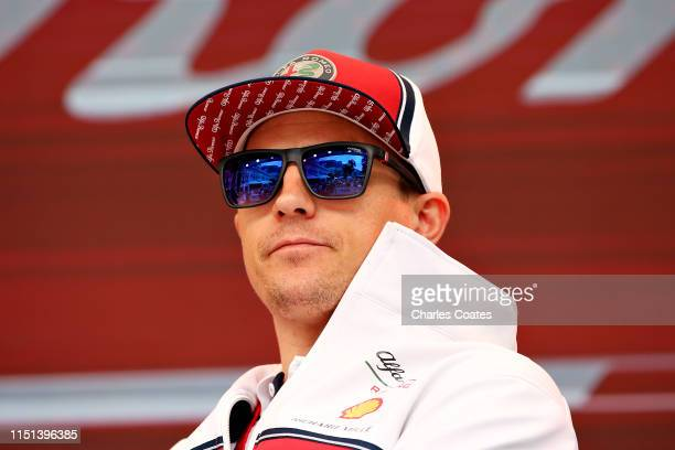 Kimi Raikkonen of Finland and Alfa Romeo Racing looks on from the fan stage during previews ahead of the F1 Grand Prix of Monaco at Circuit de Monaco...