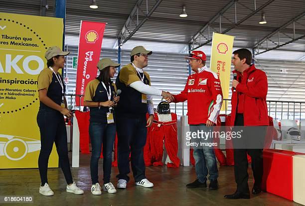 Kimi Raikkonen of Finland and Ferrari and Andres Cavallari Shell Retail Mexico at the Shell Eco Marathon event during the Formula One Grand Prix of...